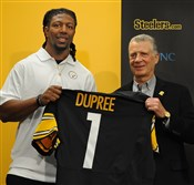 Steelers President Art Rooney II stands alongside outisde linebacker Bud Dupree, the Steelers' pick at No. 22 in the first round of the NFL Draft Thursday night.