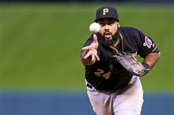 Pedro Alvarez flips the ball to first base for an out in the second inning against Cardinals at Busch Stadium Friday night.