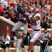 Senquez Golson of the Ole Miss Rebels intercepts a pass attempt in the endzone against O.J. Howard of the Alabama Crimson Tide on Oct. 4, 2014 at Vaught-Hemingway Stadium in Oxford, Mississippi. Mississippi beat Alabama 23-17.