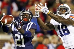 Auburn wide receiver Sammie Coates, right, goes against Mississippi defensive back Senquez Golson, left, in a 2014 NCAA game.
