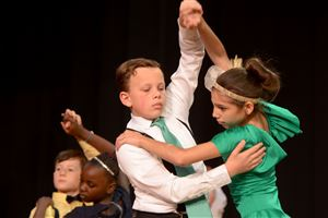 Pittsburgh Phillips' Jacob Fetzer and Lauren Shuty team up to dance the tango during the Dancing Classrooms Pittsburgh Colors of the Rainbow Ballroom Dance Championships at Allderdice High School.