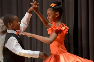 Pittsburgh Dilworth's Akiya Wilkerson and Jaden Andrews dance the merengue at the Dancing Classrooms Pittsburgh Colors of the Rainbow Ballroom Dance Championships at Allderdice High School.