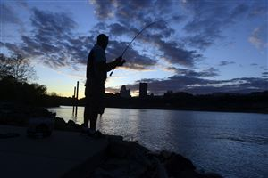 Bill Rump of Carrick fishes in the Monongahela River from Riverfront Park on the South Side.