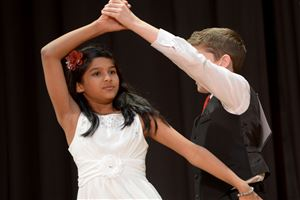 Pittsburgh Banksville's Richa Thatal and Alec Pacheco do the rumba during the Dancing Classrooms Pittsburgh Colors of the Rainbow Ballroom Dance Championships at Allderdice High School.
