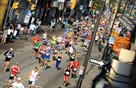Runners in the Pittsburgh Marathon Sunday proceed down Carson Street in the South Side.