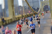 Runner cross the Andy Warhol Bridge and head to the North Side during last year's running of the Pittsburgh Marathon.