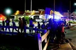 A large group of teenagers gathers near McDonald's after a disturbance closed Kennywood early on May 2.