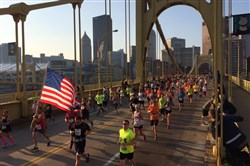 Runners cross the Andy Warhol Bridge to the North Shore from Downtown during the 2015 Pittsburgh Marathon.