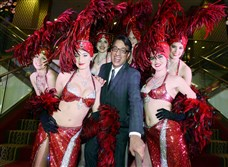 "Ted Pappas with the ""Vegas showgirls."""