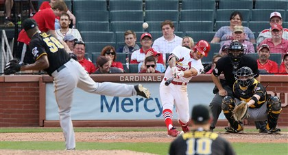 St. Louis Cardinals' Kolten Wong hits a walk-off solo home run off of Pirates pitcher Radhames Liz in the 14th inning.