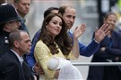 Britain's Prince William and Kate, Duchess of Cambridge, and their newborn baby princess, Charlotte Elizabeth Diana, wave to the public as they leave St. Mary's Hospital's exclusive Lindo Wing in London on Saturday.