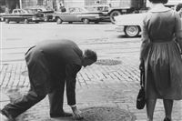 September 30, 1960: The Pittsburgh Press captured a hoax being played upon Pittsburghers trying to pick up a shiny coin affixed to a manhole cover. No identifying information of those depicted was provided. Published October 3, 1960.