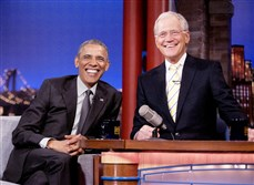 President Barack Obama with host David Letterman smile during a break at a taping of CBS The Late Show with David Letterman at the Ed Sullivan Theater in New York, Monday, May 4, 2015.