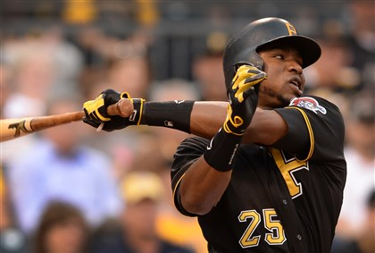 Pirates Gregory Polanco swings and strikes out against Reds in the fourth inning at PNC Park.