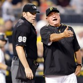 Manager Clint Hurdle argues an interference call on Gregory Polanco with home plate umpire Chris Conroy in the seventh inning Wednesday night at PNC Park. The call was the third out of the inning and cost the Pirates at least one run.