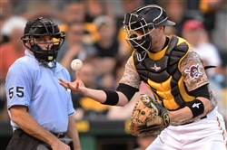 Pirates catcher Chris Stewart blocks a ball from getting past him during a May game at PNC Park.