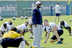 Steelers head coach Mike Tomlin watches warmups Saturday morning, May 9, 2015, during rookie minicamp on the South Side.