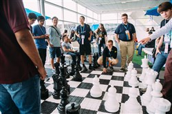 A group of students plays chess Tuesday during a break at the Intel International Science and Engineering Fair at the David L. Lawrence Convention Center, Downtown.