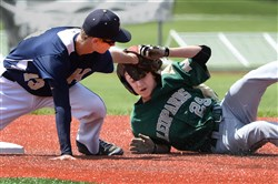 Knoch's Mike McCarty tags out Belle Vernon's Devin Judy during the WPIAL Playoffs Tuesday at Fox Chapel High School.