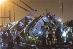 Rescue workers search for victims in the wreckage of the derailed Amtrak train in Philadelphia in May.