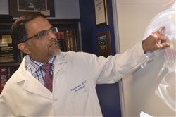 UPMC researcher Dr. Vijay Gorantla talks about the retina and the possibility of eye transplants during a meeting in an office in Scaife Hall in Oakland.