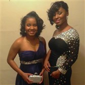 Tiara and Tierra Travis, before the Taylor Allderdice High semi-formal dance last December.