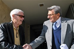 In this Nov. 9, 2010, file photo, Fran Fisher, left, congratulates former Penn State coach Joe Paterno, on his 400th career coaching win after his weekly NCAA college football news conference in State College, Pa. Fran Fisher, who broadcast Penn State football games on the radio for many years, has died. He was 91.