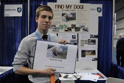 David Steele, 17, a freshmen at Nottingham High School in Nottingham, United Kingdom, holds up a picture of his dog, which inspired him to design a collar that allows owners to track their pets. His project is a finalist at the Intel International Science and Engineering Fair.