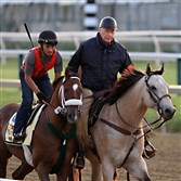Mr. Z (brown horse on left), ridden by exercise rider Edvin Vargas, trots along trainer D. Wayne Lukas (riding on right) as the Preakness Stakes entrant goes to the track for a workout at Pimlico Race Course in Baltimore, Thursday, May 14, 2015.