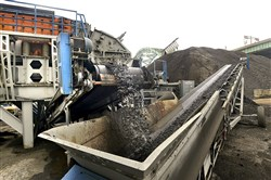 A small mountain of recycled asphalt goes through crushers and sifters to eventually become part of a new asphalt mix at the Lindy Paving asphalt plant. The plant is now running full-out now that the road construction and repaving season has started.