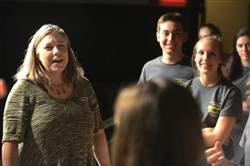 Dolores Manuel, of Fair Oaks, is the theater director and talks to her students at Our Lady of the Sacred Heart as they rehearse for a production on May 14. The school has been invited to perform at the Edinburgh Festival Fringe in Scotland
