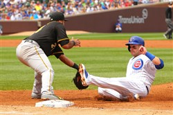 Cubs catcher Miguel Montero is tagged out on the back end of a double play by Pirates first baseman Pedro Alvarez in the second inning Sunday at Wrigley Field.
