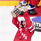 Sidney Crosby raises the trophy after Team Canada won the IIHF Ice Hockey World Championship final match against Russia in May 2015 in Prague.
