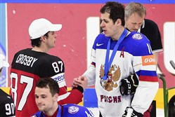 Penguins teammates Sidney Crosby and Evgeni Malkin shake hands at the 2015 world championships in Prague. Crosby, playing for Canada, and Malkin, playing for Russia, will be playing next month in a doubleheader of exhibition games at Consol Energy Center.