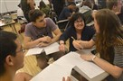 Math teacher Ro Casciato, center, goes over a calculus problem in May with Pittsburgh Allderdice High School juniors Dawill Holc, 17, and Sofia Vidic, 17.