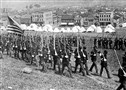 National Guard troops enter Homestead during the strike in 1892. Headquarters for the workers was located in the three-story brick building in the left background.