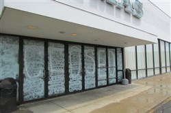 """Closed"" is painted on the front doors of the former Rave Pittsburgh 11 movie theater on McKnight Road."