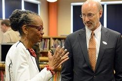 Gov. Tom Wolf listens to Pittsburgh Public Schools Superintendent Linda Lane today before his Schools That Teach roundtable discussion at Pittsburgh Roosevelt PreK-5 School in Carrick.