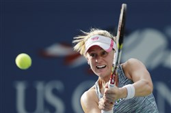 Alison Riske returns a shot to Daniela Hantuchova, of Slovakia, in the fourth round of the 2013 U.S. Open in New York.