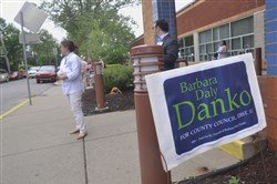 A sign urging people to vote for Barbara Daly Danko for Allegheny County Council stands Tuesday outside the Darlington Street entrance to the Jewish Community Center in Squirrel Hill.