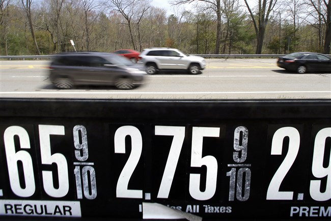 Vehicles drive past a gas station in Andover, Mass., on May 8. With more money in their pockets thanks to lower gas prices and an improved job market, AAA expects more than 37 million Americans to travel for Memorial Day, the most since 2005.