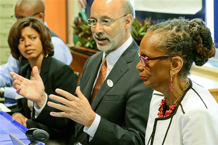 20150519radWolfLocal01 Gov. Tom Wolf, center, is flanked by Pittsburgh Public Schools Superintendent Linda Lane, right,, and Assistant Superintendent Dara Ware Allen during today's roundtable discussion.