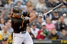 The Pirates' Jung Ho Kang hits a single against the Twins on Wednesday.