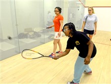 Aniya Mike, at front, a Steel City Squash student from St. Benedict the Moor School in the Hill District, gets instruction at Chatham University from Kathryn Brummer, a tutor/coach visiting from CitySquash in New York City. Bianca Troche, left, is a CitySquash student from Aquinas High School in the Bronx.