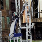 "Sarah Moore places padding along the course during the building of NBC's ""American Ninja Warrior'"" set, which is on the grounds of the former Carrie Furnace site in Swissvale."