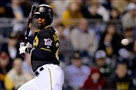 The Pirates' Andrew McCutchen tries to get out of the way as he gets hit by a pitch against the Twins in the sixth inning Wednesday.
