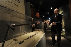 Alan Gutchess, left, director of the Fort Pitt Museum, looks on as Andrew Masich, president of the Heinz History Center, talks about a new exhibit at the Fort Pitt Museum.