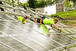 Workers for Energy Independent Solutions install solar panels on ground mounts for a home in Moon in 2015. A new study showed jobs in the solar industry have grown by 23 percent in Pennsylvania.