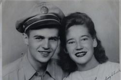 "A family photograph of Charles Johnston with Diana taken on an unknown date. On the back Diana wrote, ""I am always thinking of you."" He went missing when his B-24 bomber was shot down by the Japanese in New Guinea on April 10, 1944. It would take 70 years for his remains to be found and identified. Johnston was buried in Arlington National Cemetery on Monday, April 2, 2015."