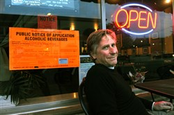 Grille 565 owner Mark Helbling, sitting outside his restaurant on Lincoln Avenue, is the first person to apply for an alcohol permit in Bellevue.